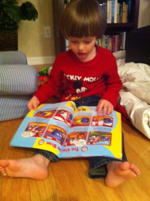 Reading his Disney Junior Magazine